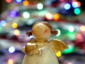 Angel holding a heart with twinkle lights