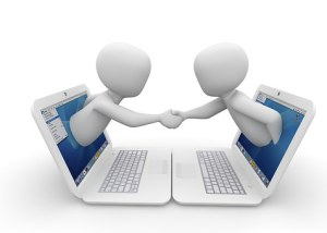 graphic with two people reaching out of laptops shaking hands