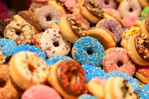 a box of mixed doughnts with sprinkles