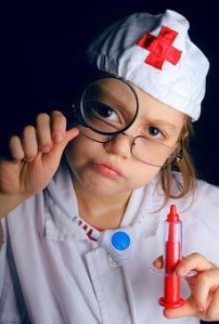 little kid dressed like a doctor