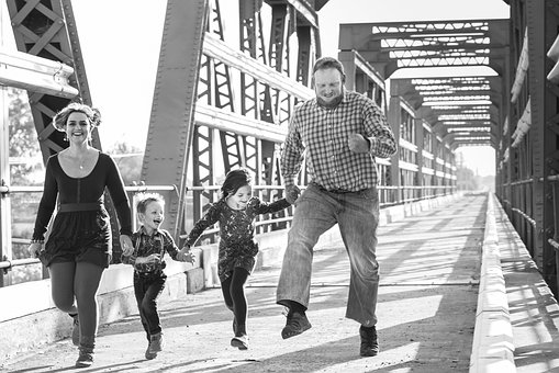 Family playing on a bridge