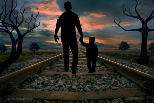 man walking off with child