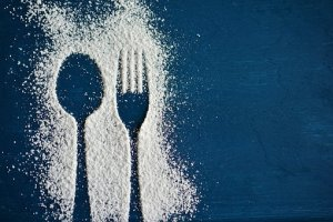 outline of spoon and fork with sugar